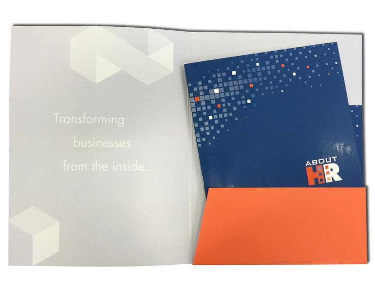 open presentation folder with booklets