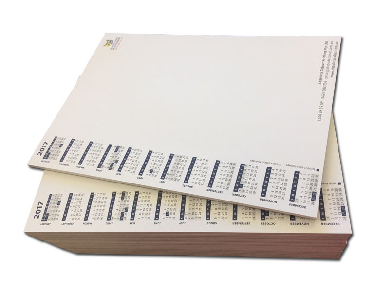 stack of calendar note pads