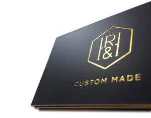 close-up-of-gold-foil-on-black-business-cards