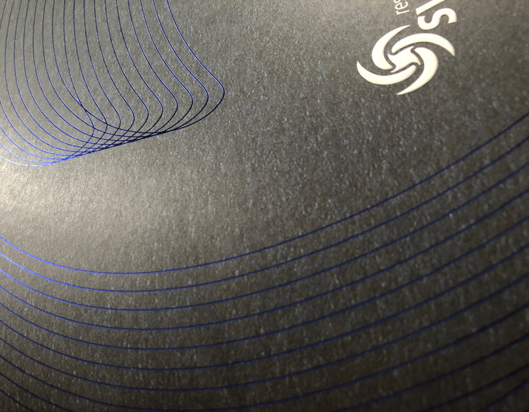 blue-foil-over-grey-uncoated-stock